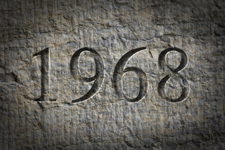 Historical year engraving 1968 on textured old surface