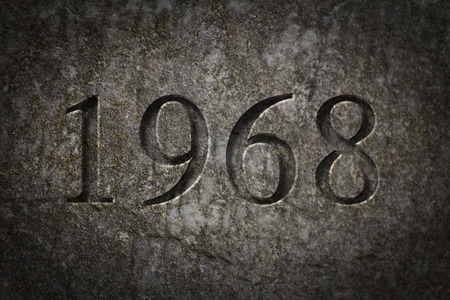 character assassination: Historical year engraving 1968 on textured old surface