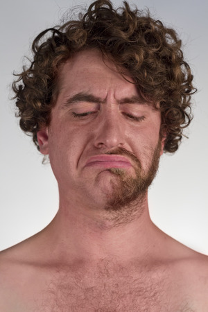 Half shaved bearded man with sad expression