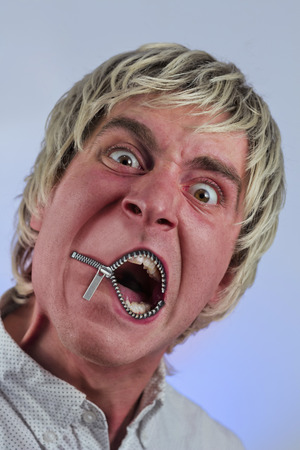 blonde haired: Zipper on mouth silences silly blonde haired man