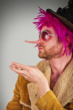 bum: Lying pink haired bearded bum lunatic man with cool sunglasses