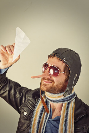 panache: Aviator pilot with giant long liar nose Stock Photo