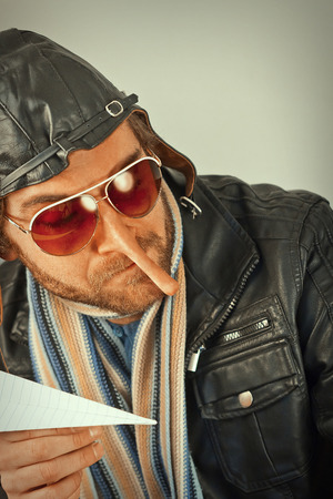 panache: Aviator pilot with giant long liar nose Stock Photo