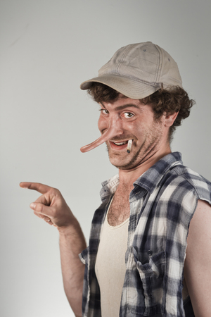 Shocked redneck points blame as his lying nose grows