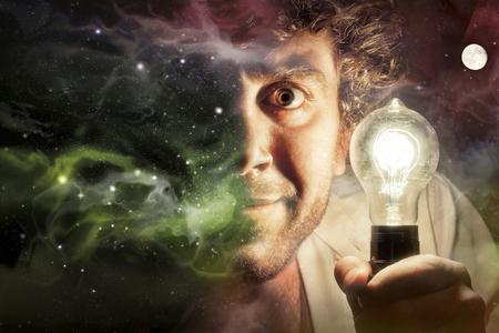 creativity: Crazy man holds edison style light bulb against beautiful universe of stars