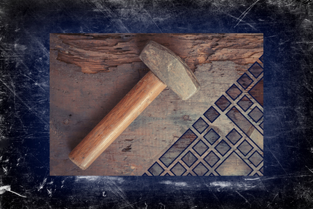 contracting: Small single handed worn sledge hammer on grunge wood background