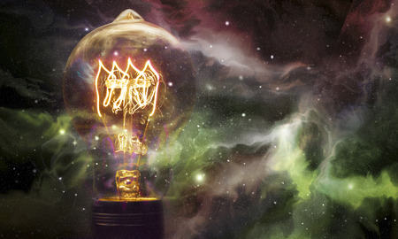 starscape: Edison style light bulbs against beautiful universe of stars and galaxies Stock Photo