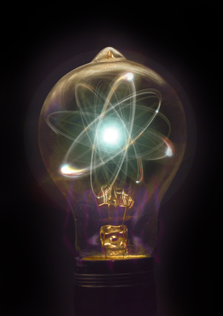 particle: Atomic particle as lightbulb filament for nuclear energy imagery Stock Photo