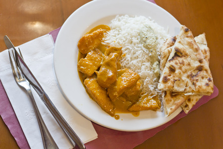 indian Fish curry with basmati rice and fresh toasted naan bread