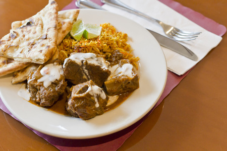 Indian Goat Lamb Vindaloo with basmati rice lime and naan flatbread