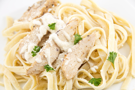 salty: Chicken Fettuccini alfredo with fresh basil leaves, delicious