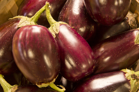 eggplant: Eggplant in a pile in basket at local farmers market