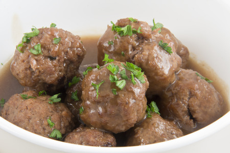 White bowl of hearty beef Swedish meatballs with parsley Stock fotó