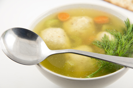 kneidl: Delicious Matzoh ball soup with crackers wine and dill