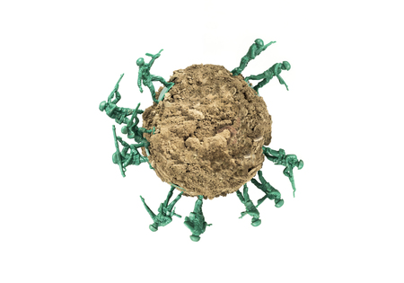 Toy soldiers march along uninhabited globe Stock Photo