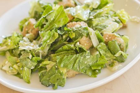 salad dressing: Fresh organic caesar salad with grated asiago cheese