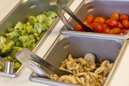 Vegetables in salad bar trays for healthy eating background image