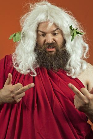 middle finger: Zeus god or jupiter and middle finger against orange background