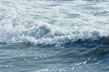 Colorful blue ocean waves in closeup tropical imagery Stock Photo