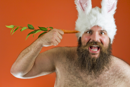 crazed: Suicidal bearded fat man wears silly bunny ears Stock Photo