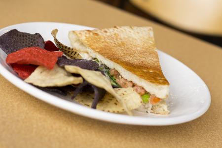 panino: Triangle sliced tuna salad panini with colorful tortilla chips