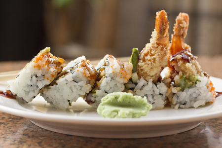Shrimp tempura avocado sushi roll with sweet sushi sauce