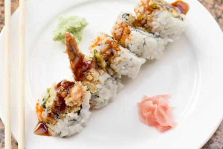 Shrimp tempura avocado sushi roll with sweet sushi sauce Stock Photo - 47889537