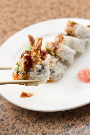 Shrimp tempura avocado sushi roll with sweet sushi sauce Stock Photo - 47889539