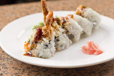 Shrimp tempura avocado sushi roll with sweet sushi sauce Stock Photo - 47889565