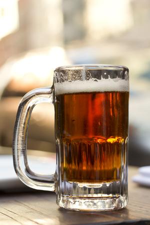 ipa: Foamy mug of cold beer dark color with lots of hops