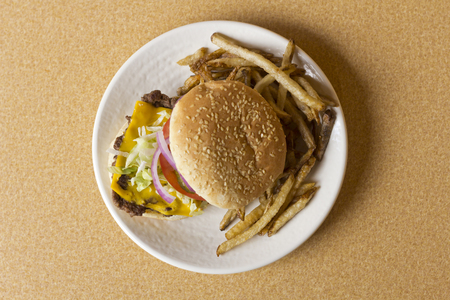 sesame seed bun: cheeseburger on sesame seed bun with lettuce tomato onions and potato skin fries