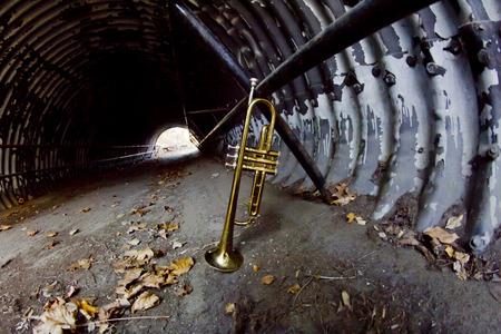 fisheye: Old worn trumpet in old city tunnel fisheye