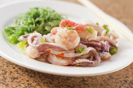 Lobster shrimp and calamari seafood salad with sesame seaweed Stock Photo