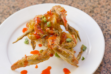 drizzle: Delicious Thai fried crab legs with sweet red sauce drizzle
