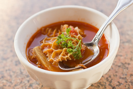 tripe: Trippa Alla Roma Tripe soup with red tomato sauce and parsley