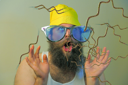 Bacteria virus sickness pouring out sick bearded mans open mouth Stock Photo