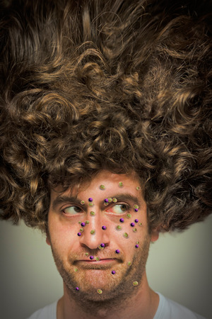 Man with giant afro with bacteria virus infection Stock Photo