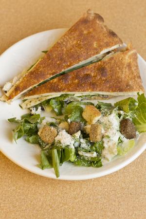 chicken caesar salad: Triangle sliced grilled chicken panini with caesar salad