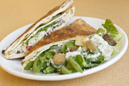caesar salad: Triangle sliced grilled chicken panini with caesar salad