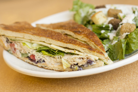 panino: Triangle sliced grilled chicken panini with caesar salad