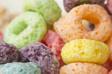 sugary: Close up multicolored sugary fruit ring breakfast cereal Stock Photo