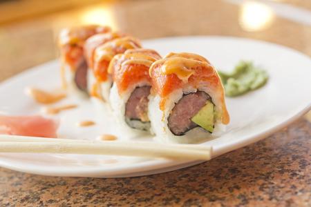 Tuna salmon roll Toro Maki sushi roll with wasabi sauce and pickled ginger 版權商用圖片