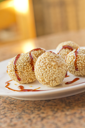 balls deep: Fancy Chinese dessert sesame donuts with sweet brown sauce