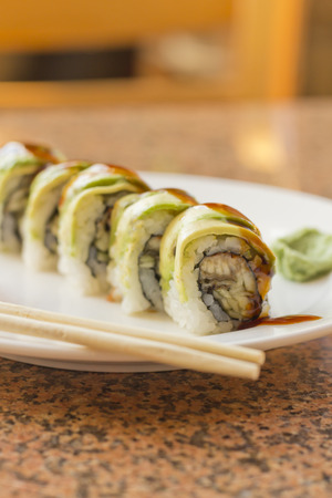 BBQ eel sushi roll with avacado wasabi and pickled ginger
