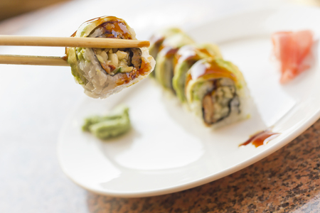 avacado: BBQ eel sushi roll with avacado wasabi and pickled ginger