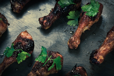 Pan with crispy and juicy grilled chicken drumsticks Stock Photo