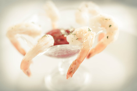 and savory: Delightful tail-on shrimp cocktail served with savory horseradish sauce Stock Photo