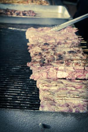 shishkabab: Many grilling chicken shish kababs at barbecue restaurant kitchen