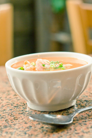 green onions: Fresh hot shrimp bisque with green onions at local restaurant