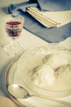 kneidl: Traditional passover matzoh ball soup with unleavened bread and wine
